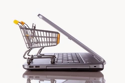 shopping cart on laptop keyboard