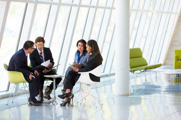 depositphotos_24644803-stock-photo-businesspeople-having-meeting-in-modern